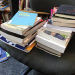 books piled on an office chair