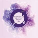 purple international women's day circle logo with drawing of flowers in white on a mottled purple background around it