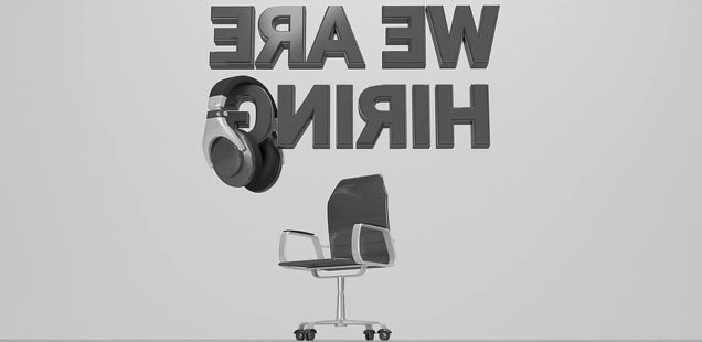 image of office chair and headphones with the words We Are Hiring spelled backward.